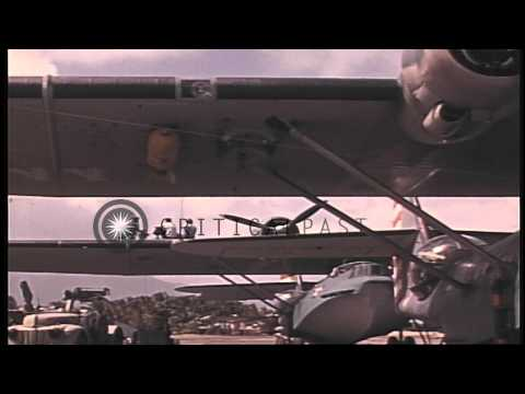 Crewmen working to repair the PBY Catalina airplane parked at the beach in the Un...HD Stock Footage