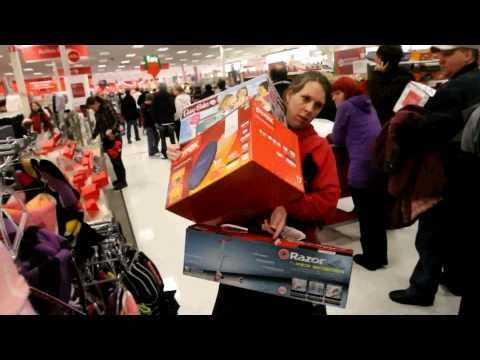 Shoppers go crazy on Black Friday, 2010, Shoppers flood into the Super Target at 4 am, in Midvale, Utah. Eager shoppers braved freezing temperatures for 9 hours, to be the first in the store to purc...