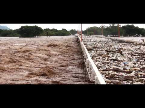 Coyuca de Catalán, antes y durante la inundacion Puente Miguel Aleman