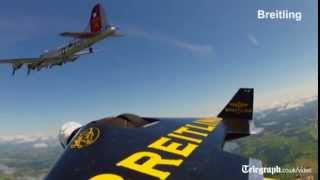 The Jetman flies alongside B17 bomber plane