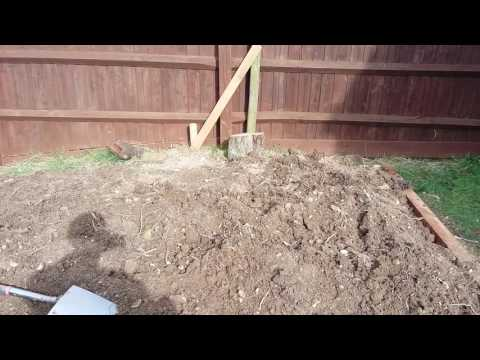 How to construct a raised bed, temporary fence repair and backyard orchard update.