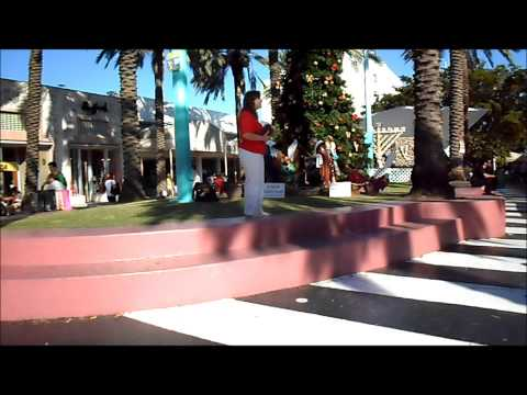 MIAMI MAN ALMOST HIT WOMAN PREACHER AT CHRISTMAS TIME
