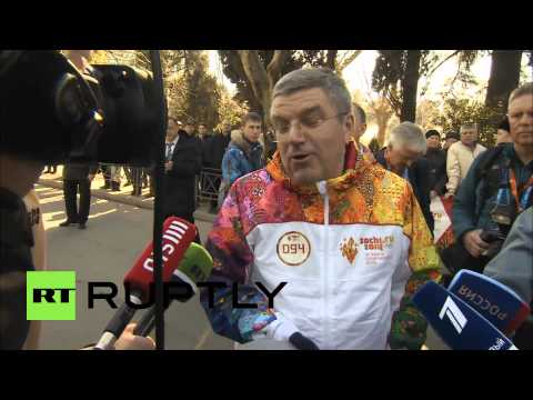 Russia: IOC head Thomas Bach runs with Olympic torch