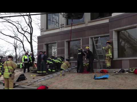 Video: Firefighters rescue window washer after falling into hole