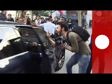 Protesters attack Spanish finance minister's car in Barcelona after political rally