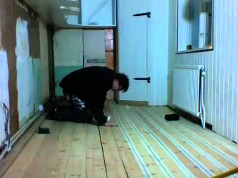 Filling cracks in wood floor youtube for Wood floor crack filler