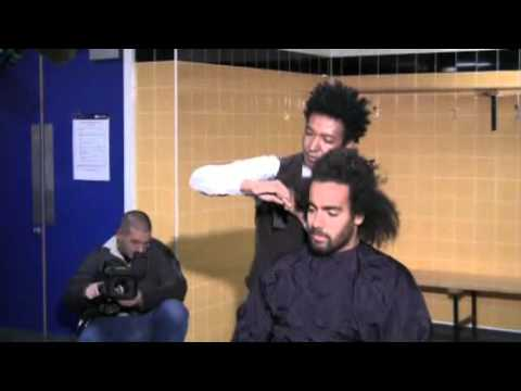 Hull City player Tom Huddlestone gets his haircut at the KC Stadium