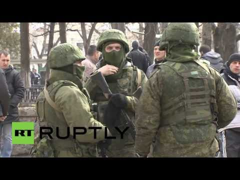 Ukraine: Members of local self-defense units patrol the streets around Crimean Parliament