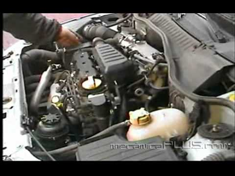 Afinación GM Corsa 2005 1.8 L. - Poniendo la tapa del motor - www.mecanicaplus.com