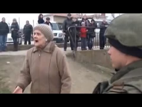 Russian occupiers in Crimea pushed down protesting Ukrainian old lady