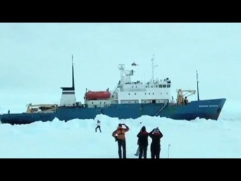 A helicopter is set to rescue 52 passengers and four crew members on a Russian ship stranded in the...  euronews, the most watched news channel in Europe      Subscribe for your daily dose of international news, curated and explained:http://eurone.ws/10ZCK4a      Euronews is available in 13 other languages: http://eurone.ws/17moBCU  http://www.euronews.com/2013/12/30/helicopter-set-to-rescue-passengers-aboard-stranded-antarctic-ship-akademik- A helicopter is set to rescue 52 passengers and four crew members on a Russian ship stranded in the Antarctic after earlier attempts to free them were hampered by bad weather.  Scientific research vessel Akademik Shokalskiy has been stuck in sea ice off the coast of Antarctica - 185 kilometres east of Dumont D\'Urville - since Christmas Day.  The ship is carrying 74 people, including scientists, tourists and crew. They are said to be in good spirits with ample food supplies.  Russia said on Monday Chinese ship the Snow Dragon would send a helicopter. It had attempted a rescue by sea, but this was halted due to thick ice. A similar attempt by Australian icebreaker The Aurora Australis was also thwarted because of blizzards.   Find us on:      Youtube http://bit.ly/zr3upY      Facebook http://www.facebook.com/euronews.fans      Twitter http://twitter.com/euronews
