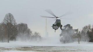 AP : Raw: Marine One Blows Snow on Photojournalists