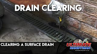 Surface drain unblocking