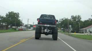Random Jacked-up Truck With Huge Tires