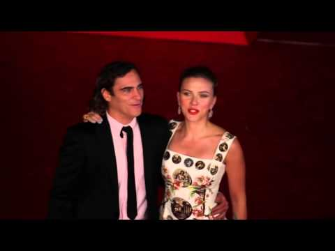 The Master star Joaquin Phoenix and The Avengers star Scarlett Johansson pose to