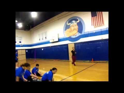 Hannah Williams teaching a badminton lesson plan at middle school