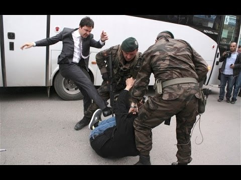 prime minister's adviser kicking a protester on soma