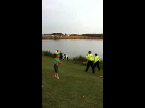 Man pushes officer into lake at concert