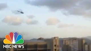 Helicopter Swoops Over Venezuela Supreme Court Amid Explosions | NBC News