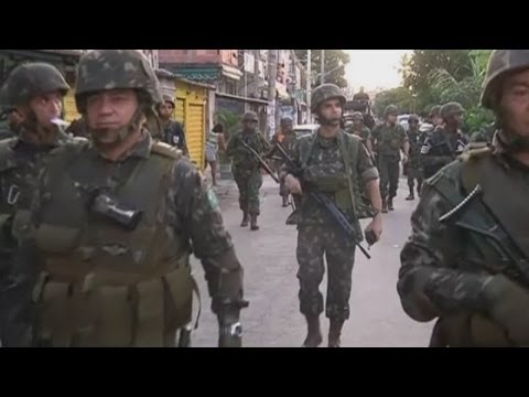Brazil favelas militarised: Army occupies Rio slums ahead of World Cup