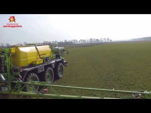 Spraying grass whit company logo