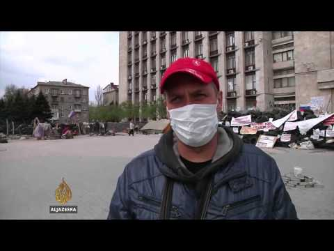 Pro-Russian protesters in Ukraine defiant as truce holds