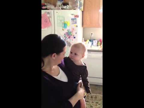 Baby squeezes the crap out of a fruit snack
