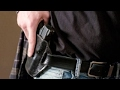 Arkansas Gov OKs guns in bars, churches, on college campuses