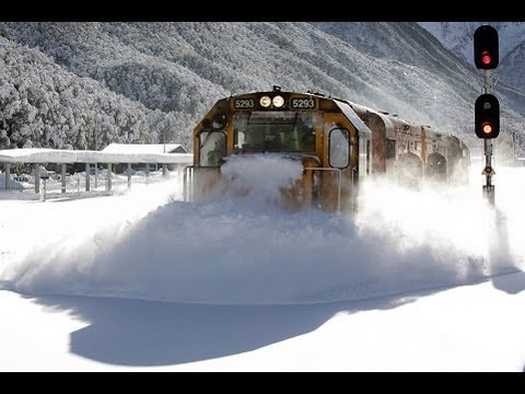 Spectacular footage Train plowing through deep snow  Arthurs Pass, Kiwirail attempting to plow a route through to Christchurch today from Arthurs Pass made for some spectacular images.
