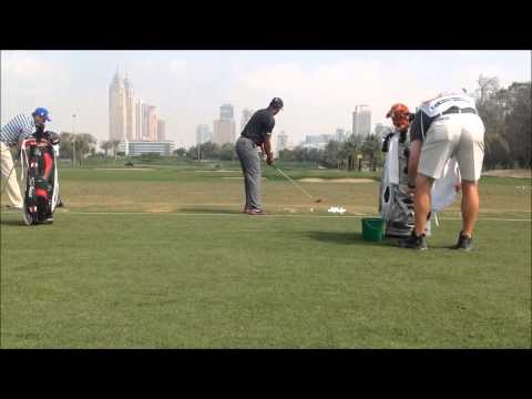 Tiger Woods swing on the range at the 25th Omega Dubai Desert Classic 2014