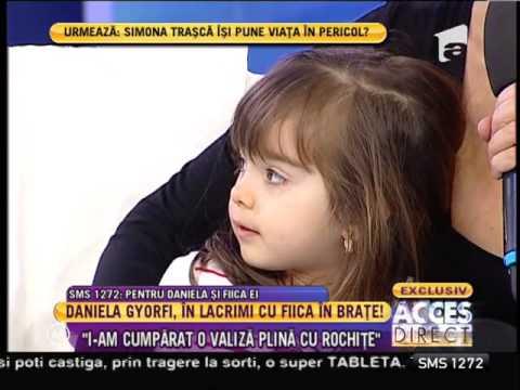 Daniela Gyorfi!, în lacrimi cu fiica în braţe!