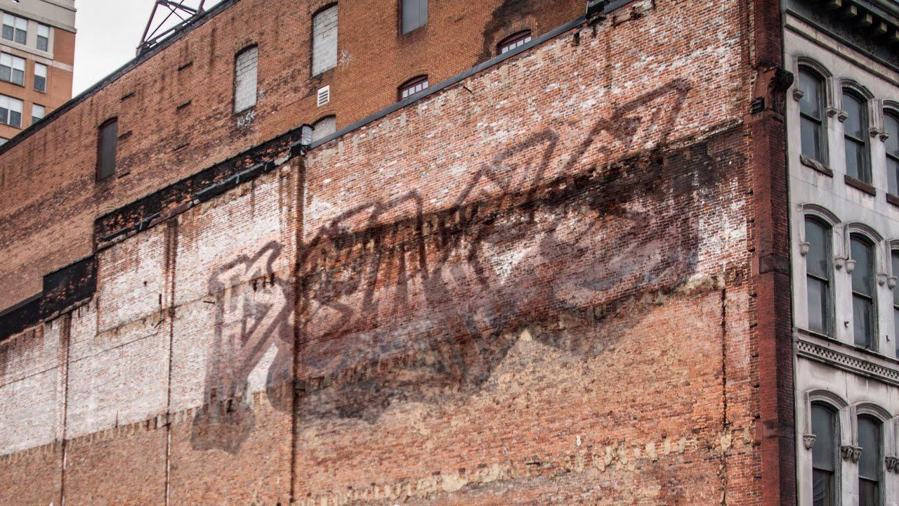 Spray Painting A Brick Wall