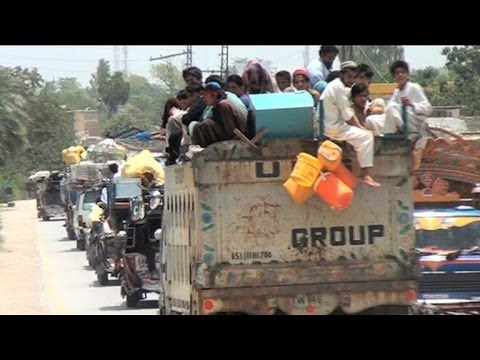 Tens of thousands flee Pakistan offensive against Taliban