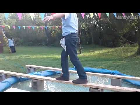 Mom and daughter video tape Dad's funny obstacle course challenge