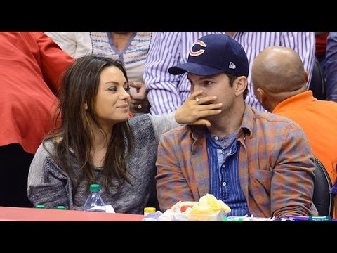 Mila Kunis and Ashton Kutcher Celebrate Their Pregnancy on the Kiss Cam!