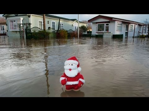 Floods and power cuts on Christmas Day as storms strike UK