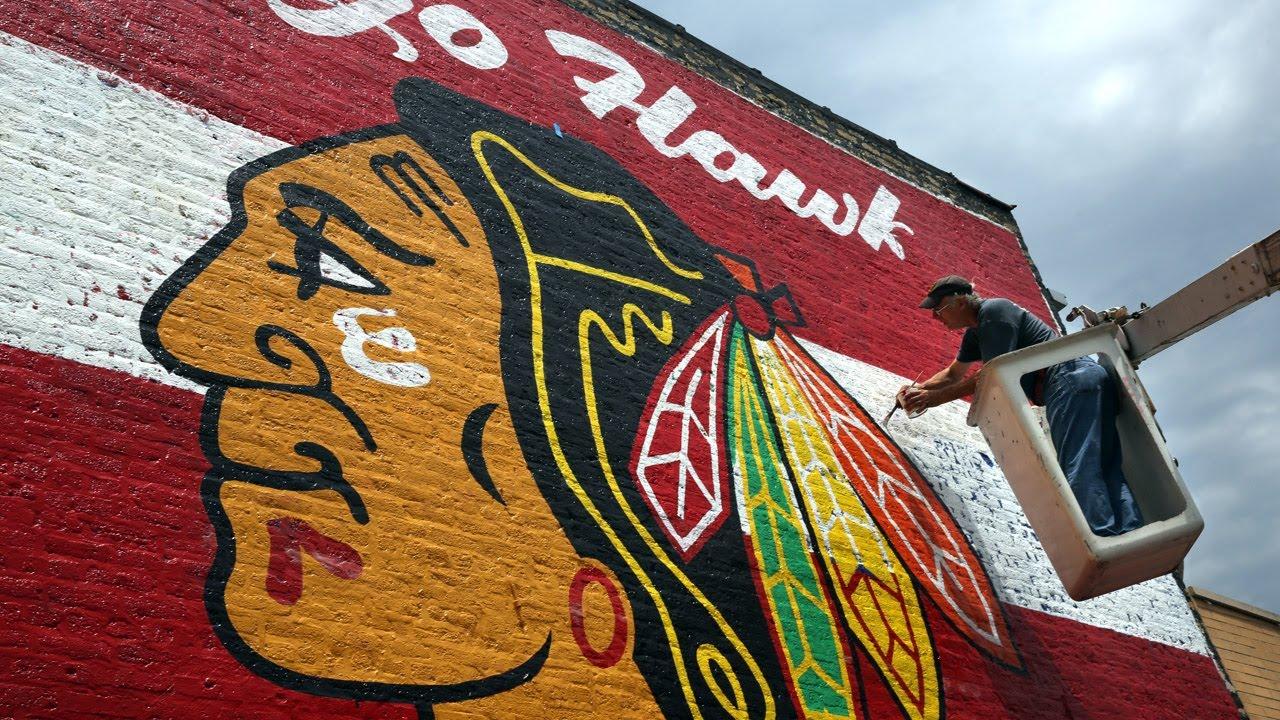 Giant blackhawks mural painted on brick wall youtube for Blackhawks mural chicago