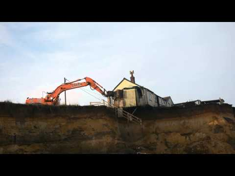 Demolition of the last house at the end of Beach Road, Happisburgh, Norfolk. 12/12/13