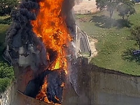 Raw: Fire Crews Burn House on Texas Cliff