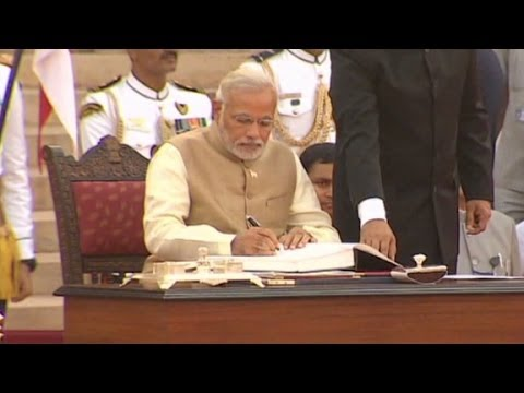 Narendra Modi takes sworn in as India's new prime mi...