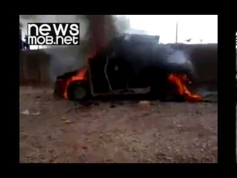 Burning vehicle belonging to government forces in Anbar province, Iraq