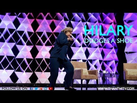 Women Throws Shoe At Hilary Clinton
