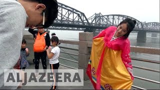 Chinese tourists flock to North Korean border despite nuclear threat