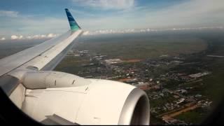 Garuda Indonesia landing at Sjamsudin Noor Airport in Banjarmasin view on youtube.com tube online.