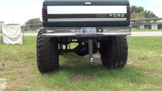 HUGE LIFTED UP 4X4 FORD TRUCK WITH LIFT KIT AND BIG TIRES