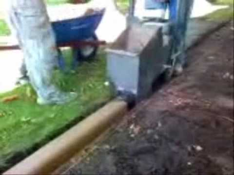 Installation Of Concrete Landscape Edging Curbing By