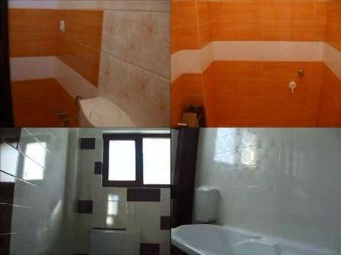 Interioare baie apartament,placat gresie,faianta alba si orange,alba si maro.