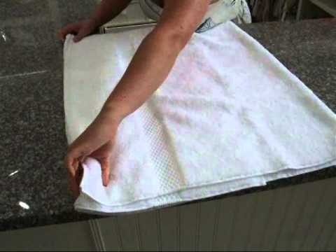 Space saving french folding technique for towels youtube for How to fold decorative bathroom towels