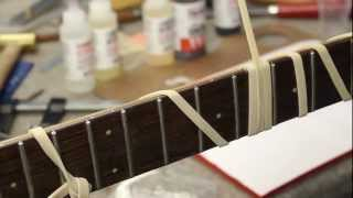 Watch the Trade Secrets Video, Rare black Dan Armstrong bass: fretboard repair