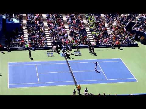 Novak Djokovic playing tennis with kids at Arthur Ashe Kids' Day